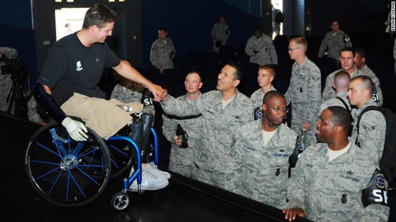 Brian Kolfage meets with American airmen at a military base in Germany in 2012.