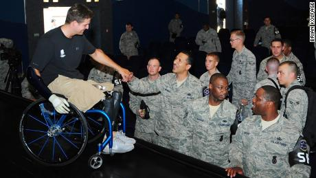 Brian Kolfage meets American airmen in 2012 at a military base in Germany.
