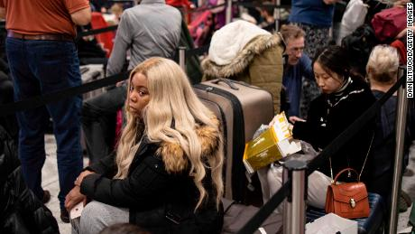Passengers wait for announcements at Gatwick South Terminal on December 20