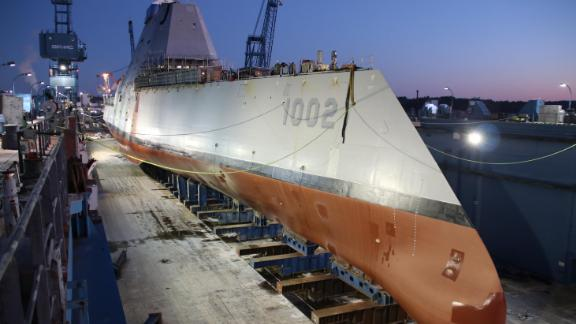 The future US stealth destroyer, USS Lyndon B. Johnson, is made ready before flooding of the dry dock in Maine in December.