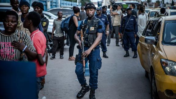 Police patrol outside the election commission headquarters in Kinshasa.