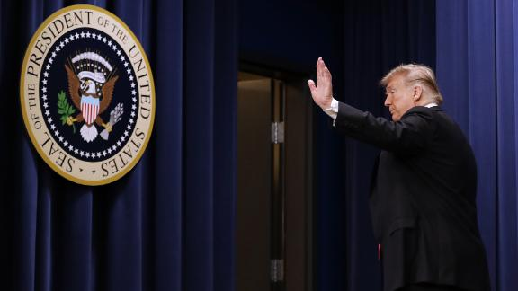 US President Donald Trump leaves the stage after he signed the Agriculture Improvement Act during a ceremony in the South Court Auditorium of the Eisenhower Executive Office Building December 20, 2018 in Washington, DC.