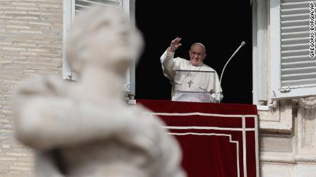 Pope Francis waves to the faithful in St. Peter's Square, at the Vatican.