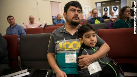 Eliseo Jimenez and his 5-year-old son Christopher watch a worship service at Umstead Park United Church of Christ in Raleigh. Jimenez, 40, has been living in the church since October 2017.