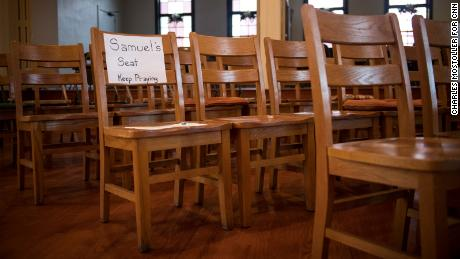 "A sign marks the chair where Samuel Oliver-Bruno used to sit during services at CityWell United Methodist Church. The Rev. Cleve May says his congregation is grieving, but not giving up. ""The story of God in this world is God showing up in the midst of injustice and oppression,"" he says."