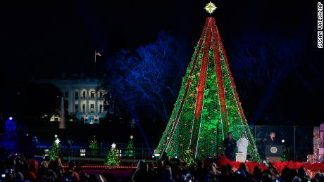 President Donald Trump and first lady Melania Trump light the National Christmas Tree on the Ellipse near the White House in Washington, Wednesday, November 28.