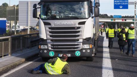 """Yellow vest"" protesters turn out Saturday near toll booths on the A9 highway in Le Boulou, France."