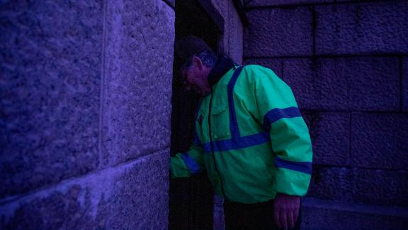 A National Park Service worker prepares to lock the visitor bathrooms at the Lincoln Memorial on December 22.