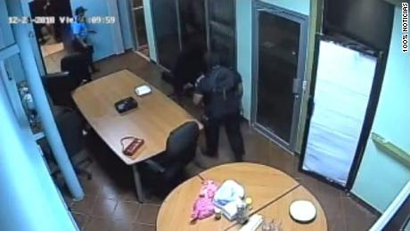 Security camera footage shows law enforcement walking inside the TV station Friday night.