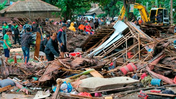 Residents inspect a house damaged by the tsunami in Carita, Indonesia, on Sunday.