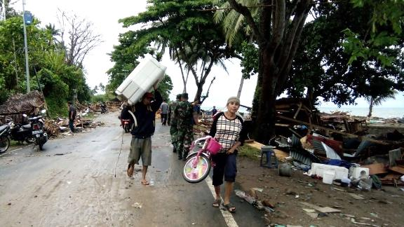 Residents evacuate from damaged homes.