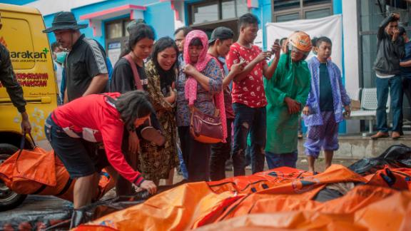 People search for relatives among the bodies of tsunami victims.