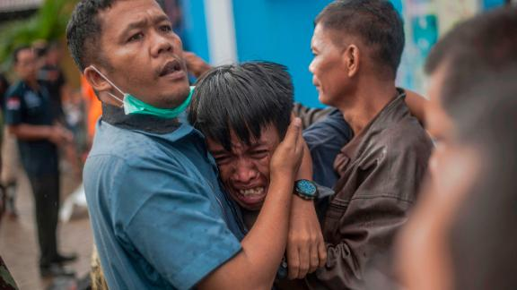 A man breaks down after identifying his relative among the bodies of tsunami victims in Carita, Indonesia, on Sunday.