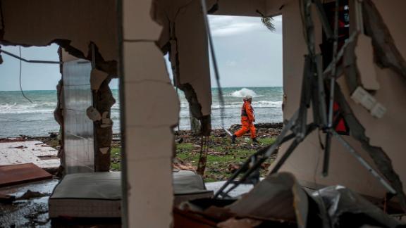 A rescuer takes part in a search for tsunami victims in Carita, Indonesia.