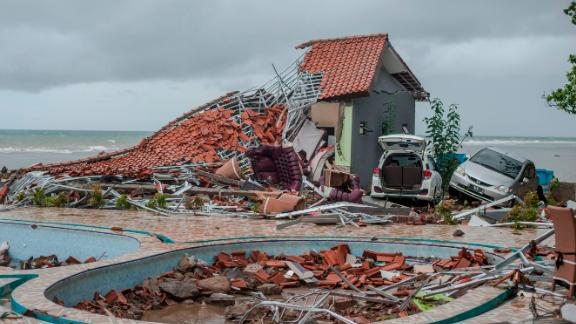 Debris litters a property that was damaged by the tsunami in Indonesia.