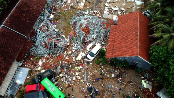 An aerial photo shows damaged buildings in Carita, Indonesia, on Sunday, a day after the area was hit by the tsunami.
