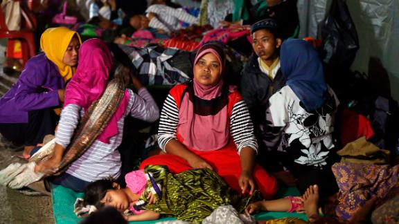 Tsunami survivors gather at temporary shelter in Tanjung Lesung, Indonesia, on Sunday.