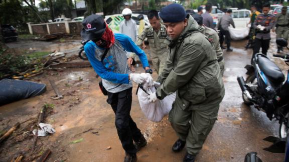 Rescue team members carry the body of a tsunami victim in Banten, Indonesia, on Sunday.