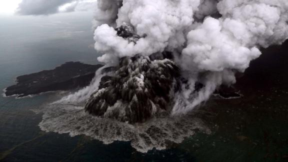 An aerial view of the Anak Krakatau volcano during an eruption in South Lampung, Indonesia, on Sunday, December 23. The tsunami is believed to have been triggered when the volcano, lying in the Sunda Strait between the islands of Java and Sumatra, erupted and set off a series of underwater landslides, according to Indonesia's Meteorology, Climatology and Geological Agency.