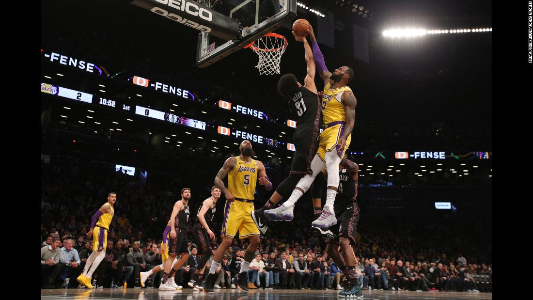 "Brooklyn Nets center Jarrett Allen blocks a dunk attempt by LeBron James of the Los Angeles Lakers during the first quarter of their basketball game in Brooklyn, New York on December 18. According to ESPN Stats & Info, <a href=""https://bleacherreport.com/articles/2811511-lebron-james-jarrett-allens-block-probably-all-over-social-media"" target=""_blank"">it was only the ninth time James was blocked in 1,850 career dunk attempts.</a>"