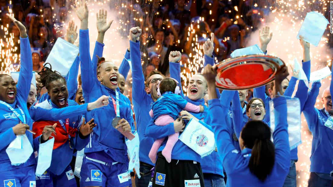French players celebrate their EHF EURO European Women's Handball Championship victory at AccorHotels Arena on Sunday December 16 in Paris, France. France won the final match over Russia 24-21 to claim the gold.