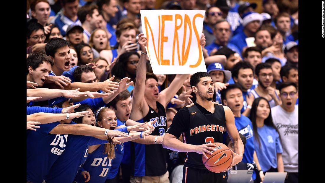 Duke Blue Devils fans taunt Jose Morales of the Princeton Tigers during the second half of their game at Cameron Indoor Stadium on December 18 in Durham, North Carolina. Duke routed the Tigers 101-50.