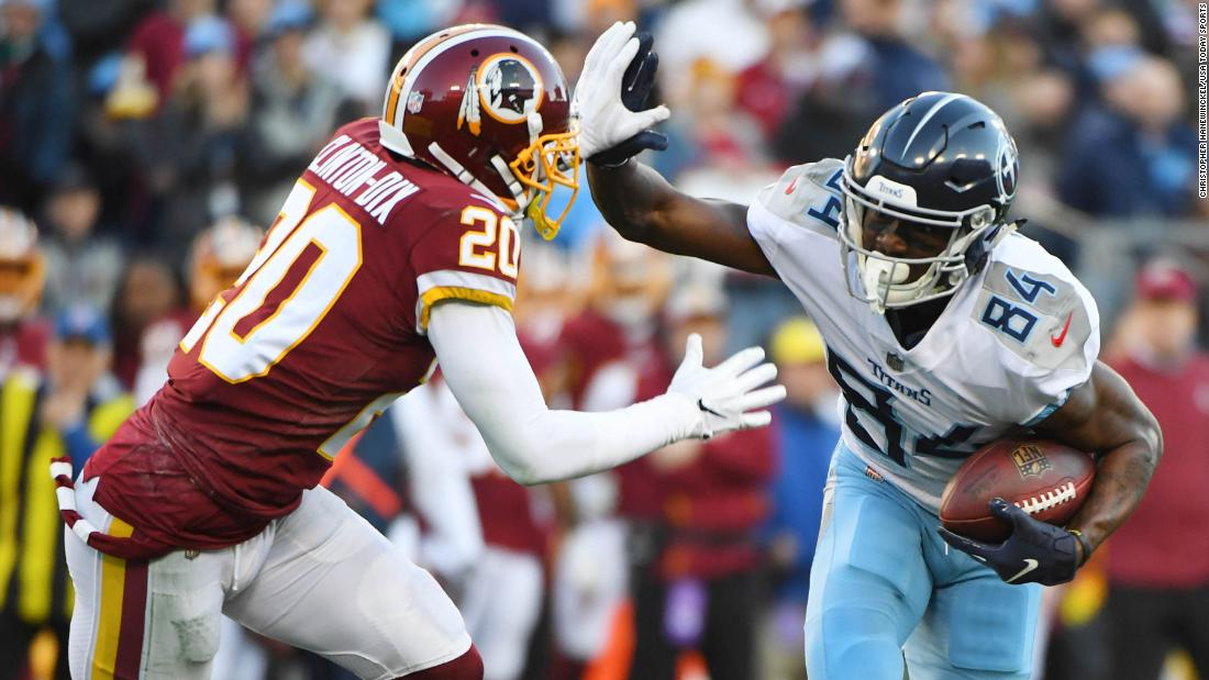 Tennessee Titans wide receiver Corey Davis fights off a tackle attempt from Washington Redskins strong safety Ha Ha Clinton-Dix during the first half of their December 22 game at Nissan Stadium in Nashville, Tennessee. The Titans won the game 25-16 to keep their playoff hopes alive.