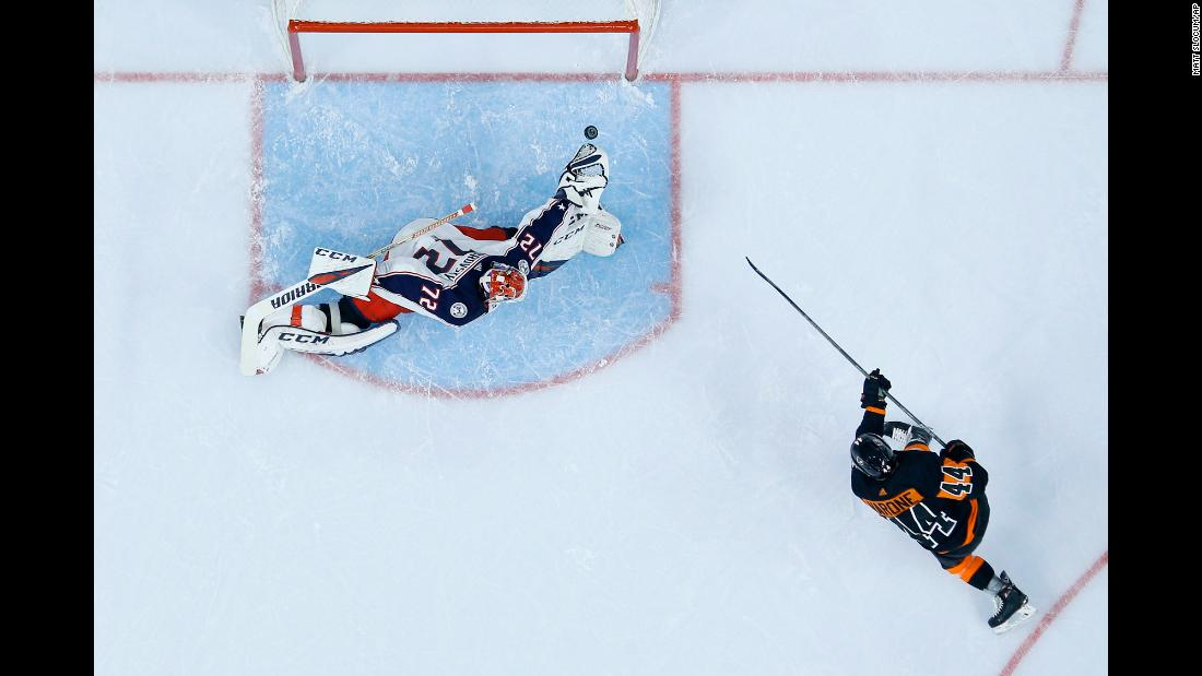 Philadelphia Flyers' Phil Varone scores a goal past Columbus Blue Jackets goaltender Sergei Bobrovsky during the second period of an NHL hockey game on December 22 in Philadelphia, Pennsylvania.