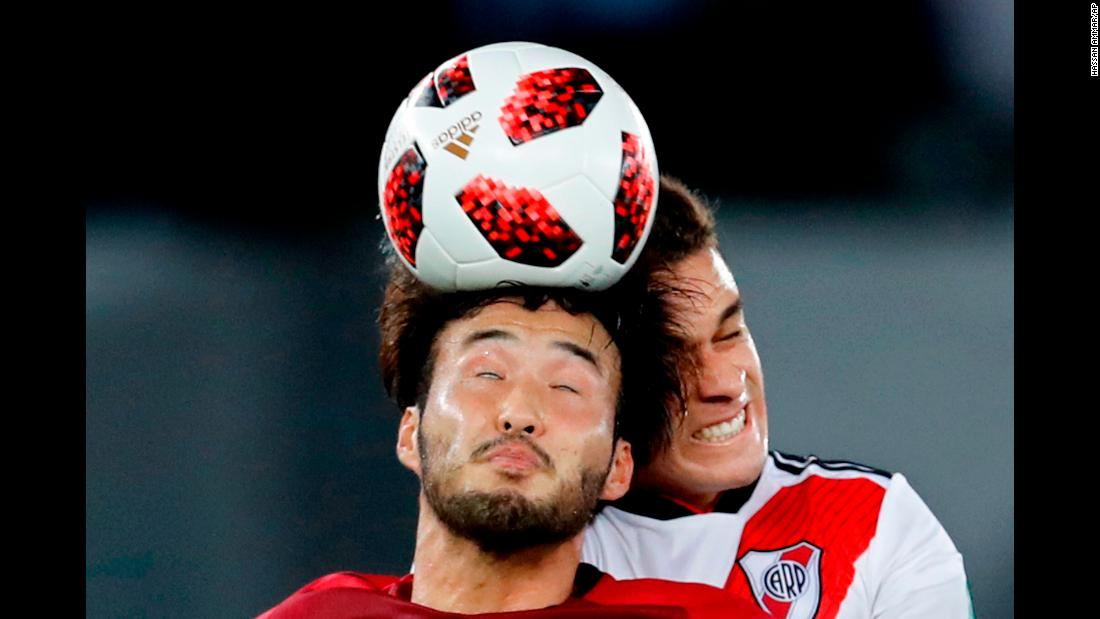 Tomoya Inukai of the Kashima Antlers and Rafael Santos Borre of River Plate battle over the ball during the Club World Cup third place soccer match at Zayed Sport City in Abu Dhabi, United Arab Emirates on December 22.