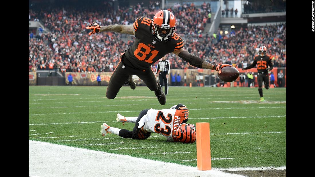 Rashard Higgins of the Cleveland Browns dives for a touchdown during the third quarter of a game against the Cincinnati Bengals at FirstEnergy Stadium on December 23 in Cleveland, Ohio. Cleveland won the game 26-18.
