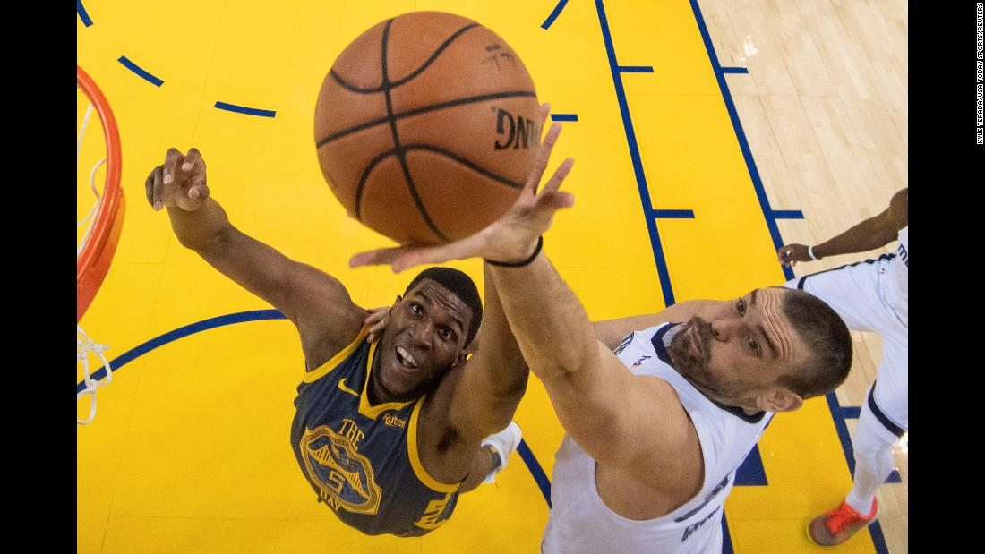 Golden State Warriors forward Kevon Looney and Memphis Grizzlies center Marc Gasol fight for a rebound during the first half of their game at Oracle Arena on December 17. The Warriors defeated the Grizzlies 110-93.