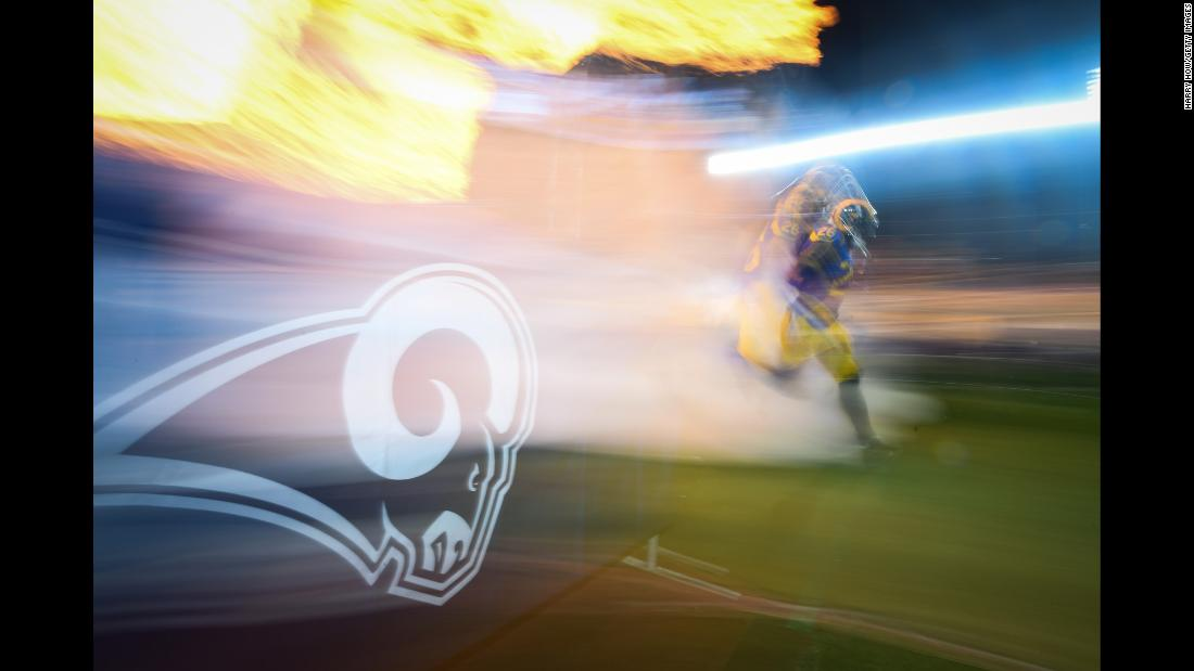 Inside linebacker Mark Barron of the Los Angeles Rams runs onto the field ahead of a game against the Philadelphia Eagles at StubHub Center in Carson, California on December 16.