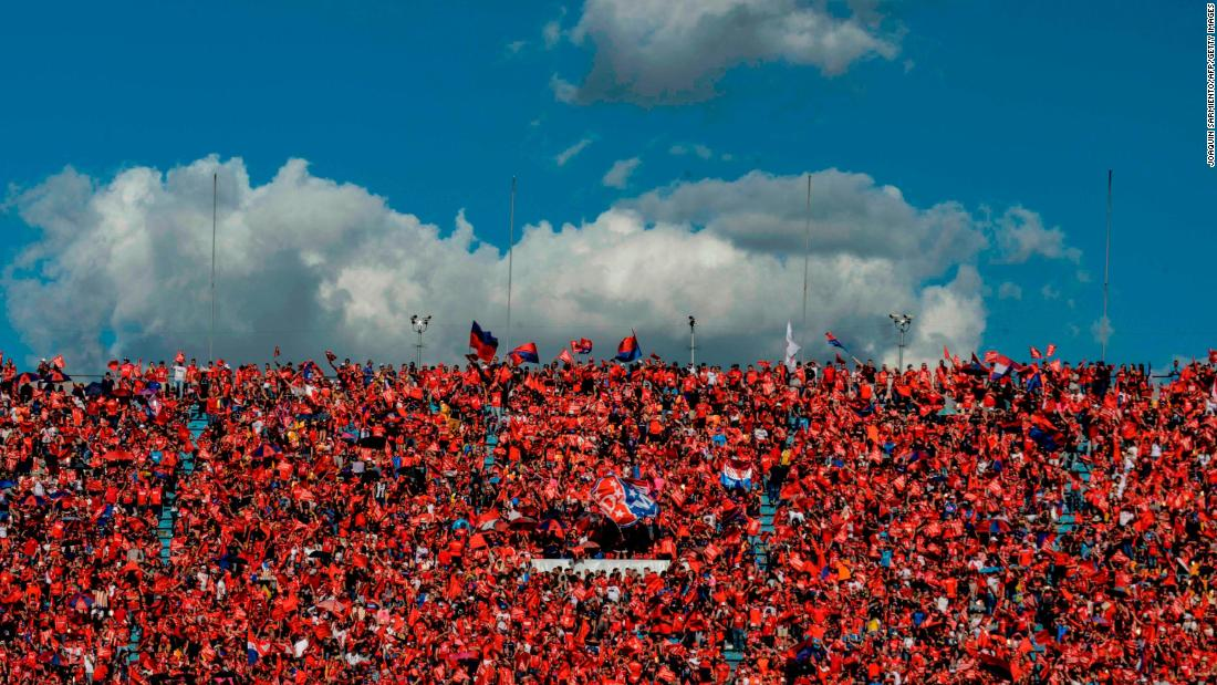 Fans of Independiente Medellin cheer before the Colombian League football final between Atletico Junior and Independiente Medellin at Atanasio Girardot Sports Complex, in Medellin, Colombia on December 16