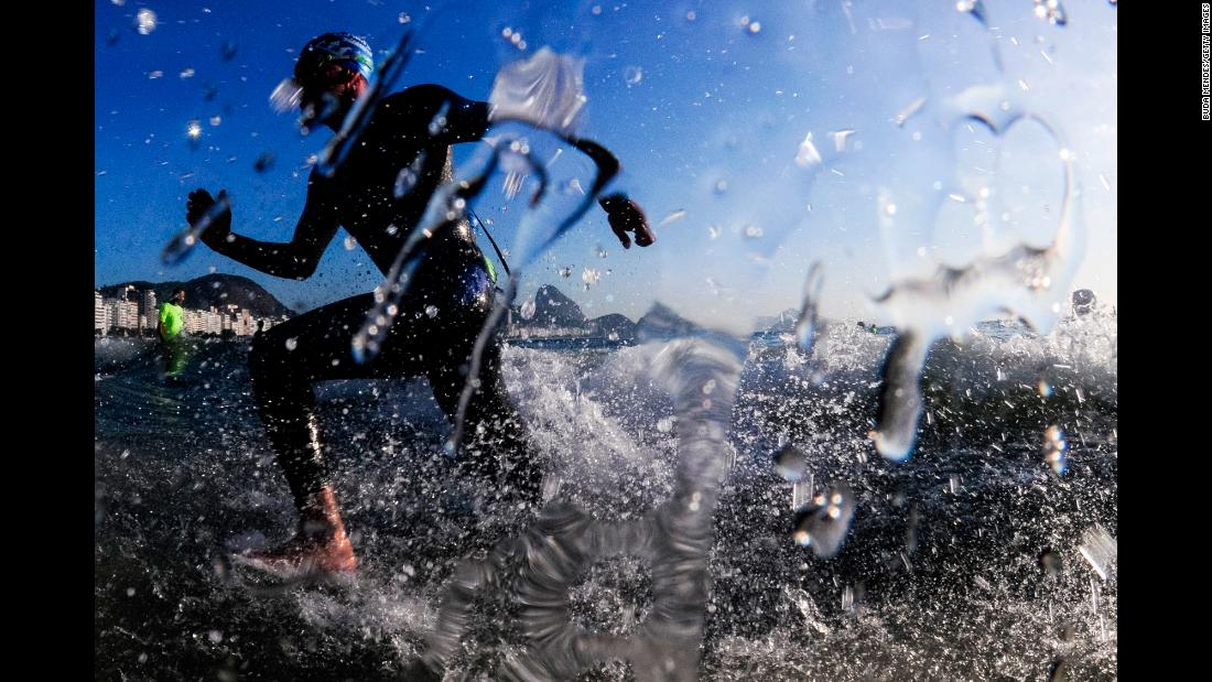 An athlete finishes the men's open water swimming competition during the Rei e Rainha do Mar at Copacabana Beach on December 22, in Rio de Janeiro, Brazil.