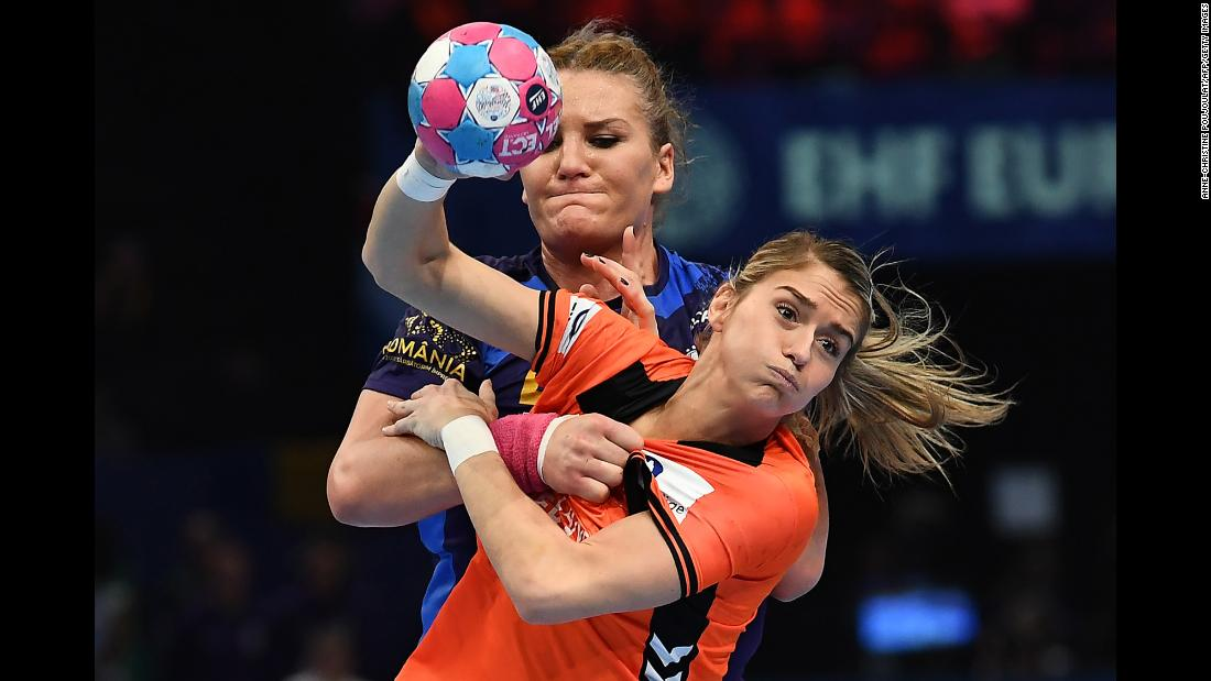 Romania's Crina Elena Pintea (back) battles with Estavana Polman of the Netherlands during the EHF EURO European Women's Handball Championship third place match at the AccorHotels Arena in Paris on December 16.
