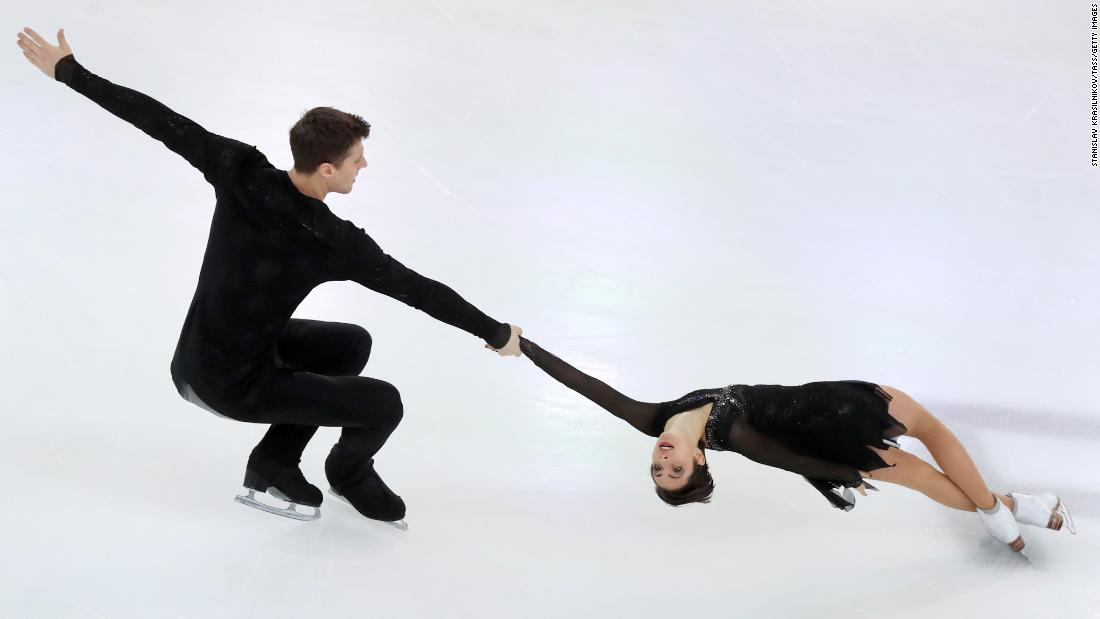Figure skaters Natalya Zabiyako and Alexander Enbert perform a death spiral during a pairs free skating event at the 2019 Russian Figure Skating Championships.
