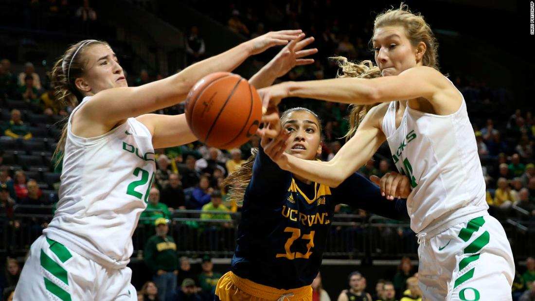 Oregon's Sabrina Ionescu, left, and Lydia Giomi, right, battle UC Irvine's Tahlia Garza, center, for a rebound during the second half of an NCAA college basketball game in Eugene, Oregon on Friday, December 21.