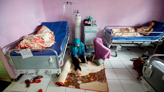 Tsunami survivors rest at a hospital in Pandeglang, Indonesia, Monday. Doctors are working to help survivors, and rescuers are looking for more victims from a deadly tsunami that smashed into beachside buildings along an Indonesian strait.