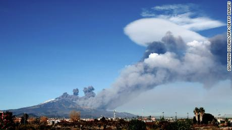 Smoke rises over the city of Catania during an eruption of Mount Etna on Monday.