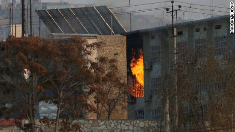 Flames rise from a government building after an explosion and attack by gunmen, in Kabul, Afghanistan, on December 24.