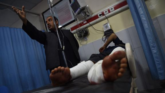 A wounded man receives treatments at the Wazir Akbar Khan Hospital after the car bomb attack in Kabul.