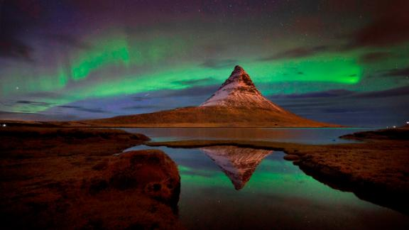Kirkjufell, Iceland: The aurora borealis, or northern lights, are seen over Kirkjufell, a 463-meter mountain on the west coast of Iceland.