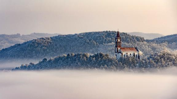 Soshartyan, Hungary: As December temperatures fall below 0 Celsius (32 F), a church stands above a layer of fog in the Hungarian village of Soshartyan.