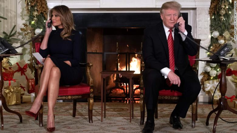 The Trumps answer calls from people to the NORAD Santa tracker phone line Monday at the White House.