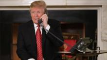 WASHINGTON, DC - DECEMBER 24: U.S. President Donald Trump takes phone calls from children as he participates in tracking Santa Claus' movements with the North American Aerospace Defense Command (NORAD) Santa Tracker on Christmas Eve in the East Room of the White House December 24, 2018 in Washington, DC. This is the 63rd straight year that NORAD has publicly tracked Santa's sleigh on its global rounds. (Photo by Chip Somodevilla/Getty Images)