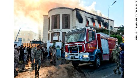 Emergency services at the scene of an attack outside the Libyan foreign ministry headquarters in the capital Tripoli.