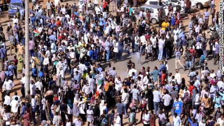 Sudanese marchers protest against the government in Khartoum on Tuesday, December 25.