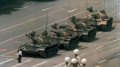 A Chinese stands alone to a series of tanks n to block Beijing's Cangan Blvd eastbound. on Tiananmen Square on June 5, 1989.