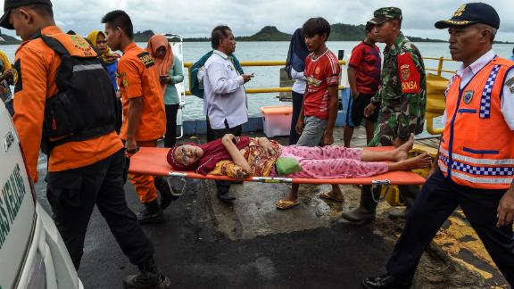 Members of an Indonesian search and rescue team carry an elderly woman on a stretcher at the ferry port after being evacuated from Sebesi Island, in Bakauheni, on Wednesday.