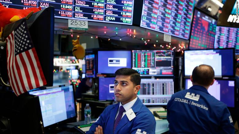 Stocks stabilize after Christmas Eve drop